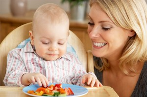 Mother-feeding-baby-veggies
